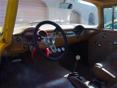 1955 Chevy, 2 door post, with a 1972 corvette engine, yellow exterior paint